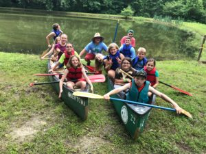 Junior campers in canoe
