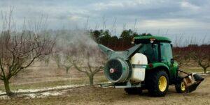 Airblast sprayer with peach trees