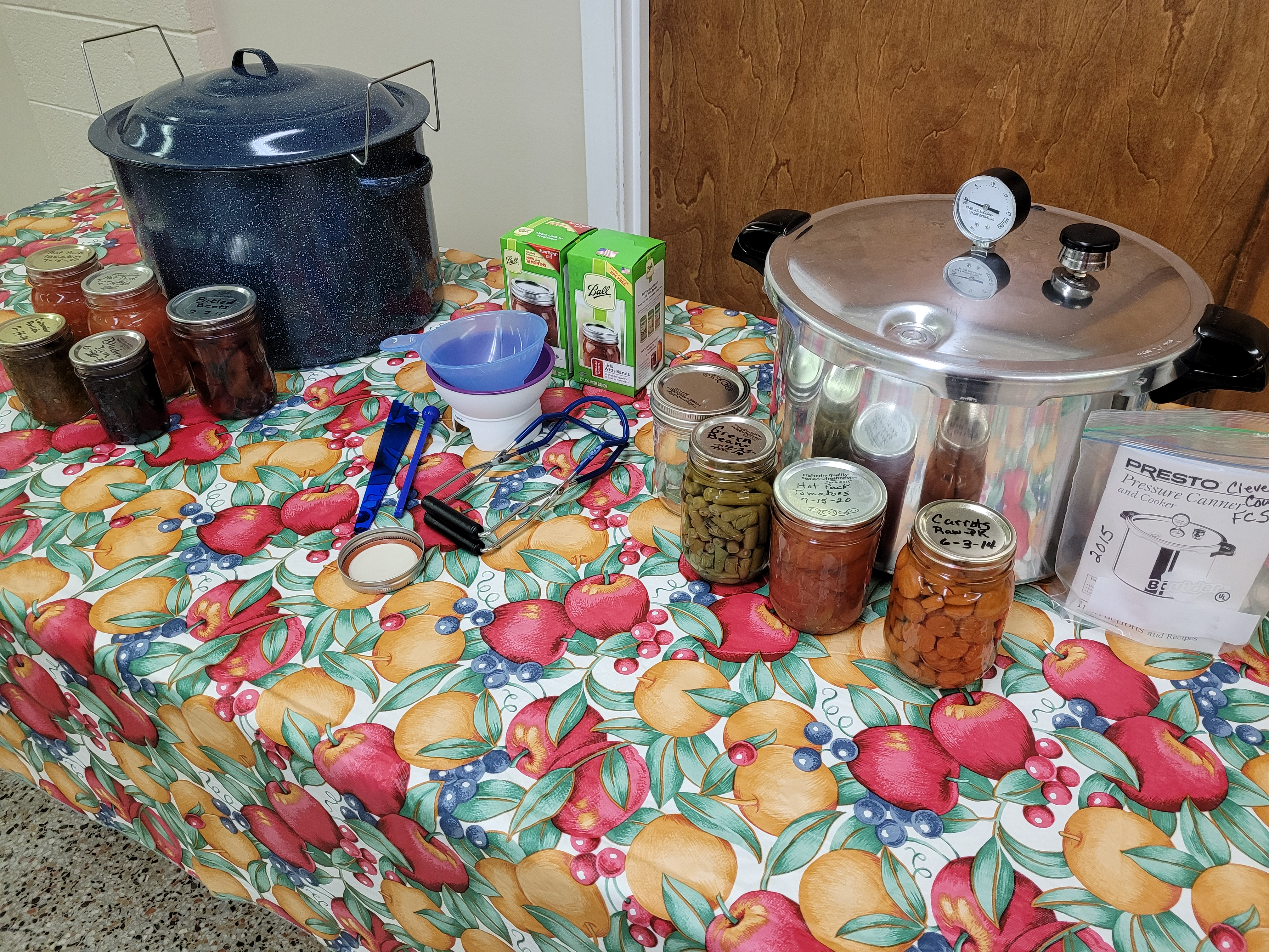 Pressure canner and jars on table